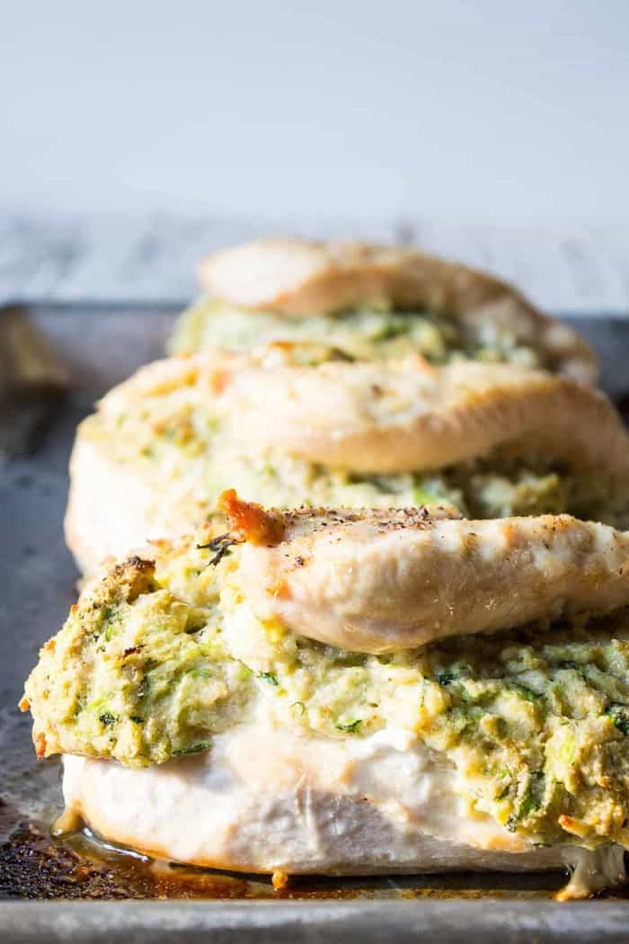 zucchini and cheese stuffed chicken breast on a tray