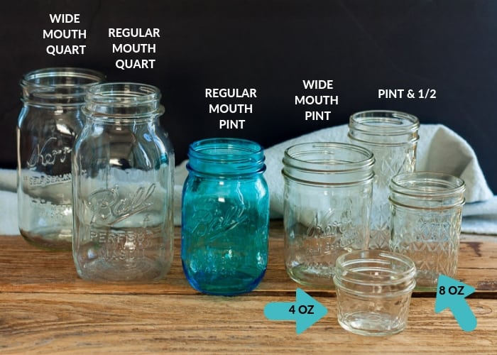 multiple kinds of jars on a wooden board showcasing canning supplies