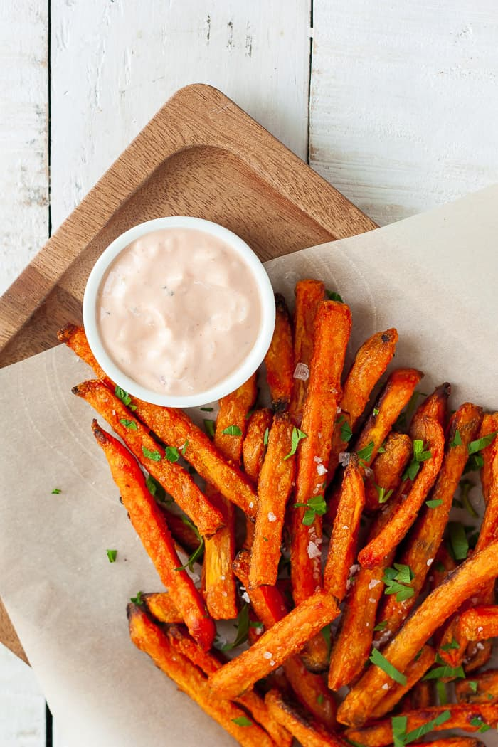 a tray of sweet potato fries with sweet potato fry dipping sauce