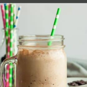 a blended iced latte in a mason jar glass with a straw