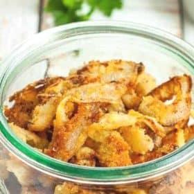 a glass bowl of crispy fried onions