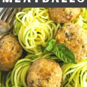 a plate of zoodles topped with gluten-free turkey meatballs