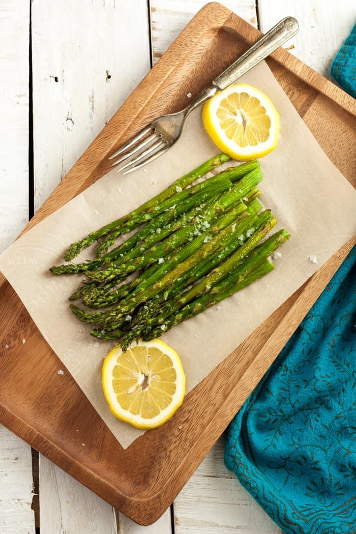 air fried asparagus with lemon and a blue cloth