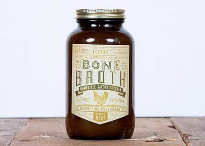 a jar of epic bone broth on a brick surface