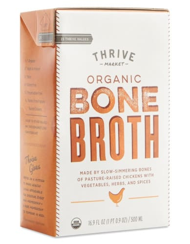 a container of Thrive chicken bone broth