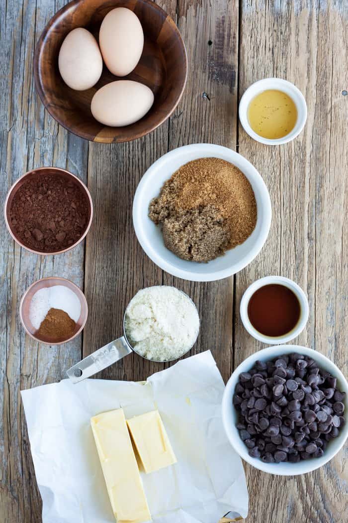 eggs, almond flour, butter, and other ingredients for making gluten free chocolate brownies