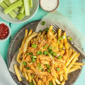 A plate of buffalo chicken fries with celery sticks and dip