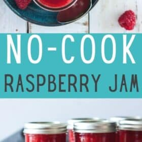 a canning jar of homemade raspberry jam on a blue plate with mint and a spoon