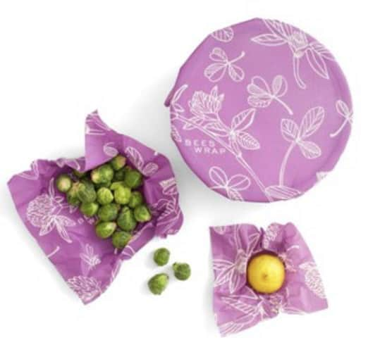 Three purple beeswrap holding food