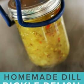 A jar of dill pickle relish with canning tongs over a canner