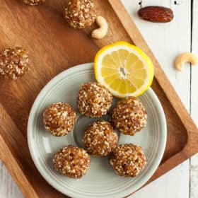 a plate of lemon bliss balls with cashews and almonds