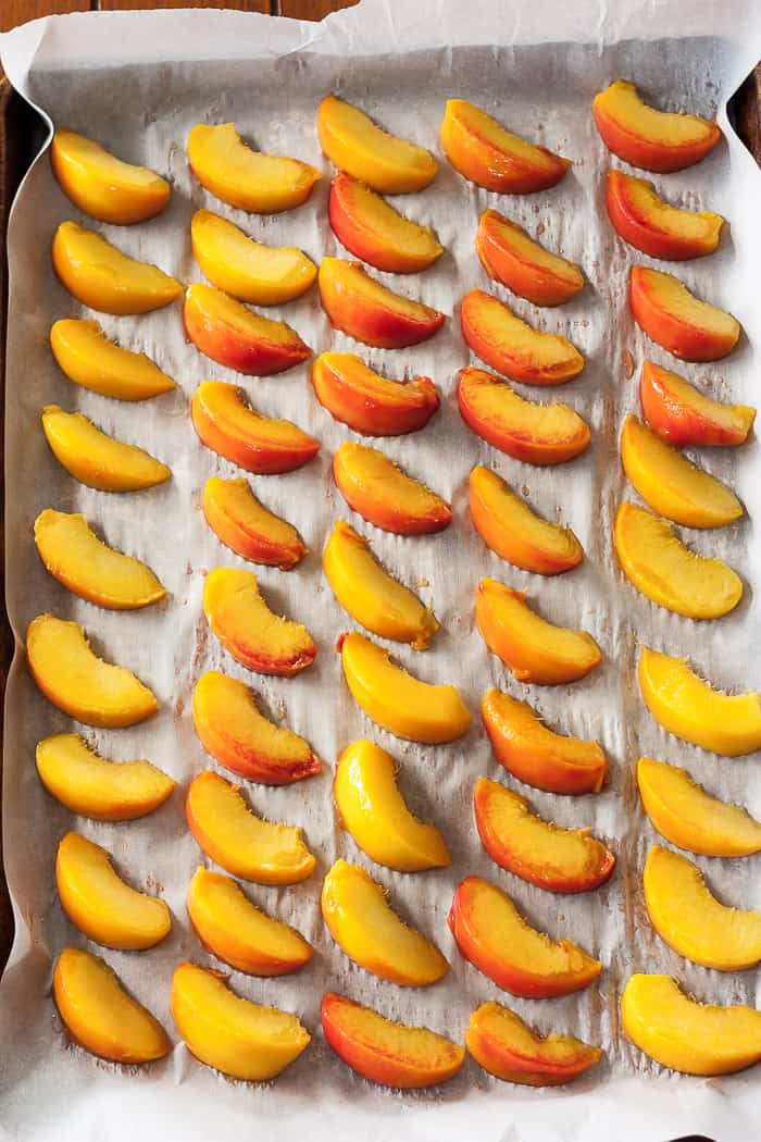 a tray of frozen peaches