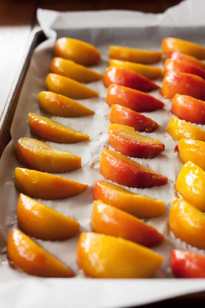 frozen peach slices on a baking tray