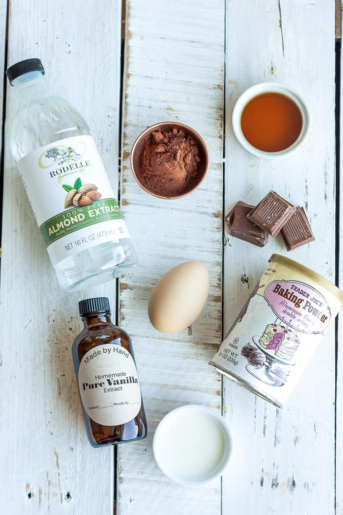 an egg, cocoa powder, and other ingredients for chocolate mug cake