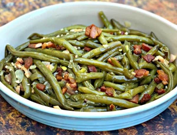 a blue bowl full of southern style instant pot green beans