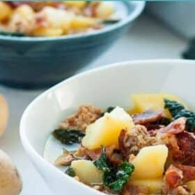a white bowl of zuppa toscana