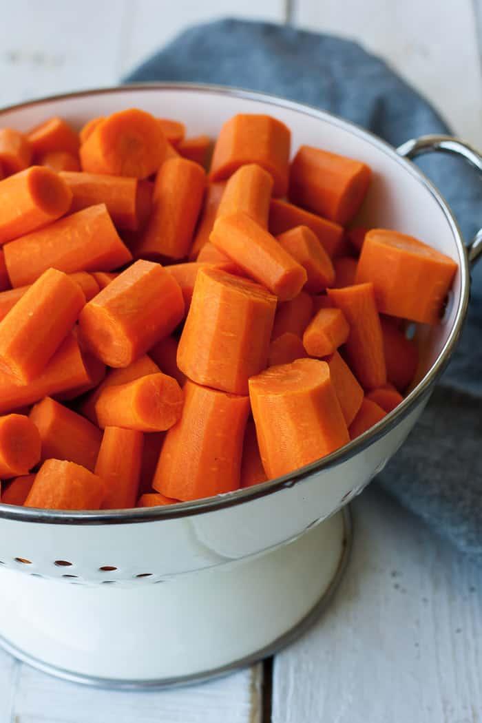 a strainer full of carrot chunks