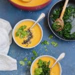 two bowls of instant pot carrot soup with garlicky greens