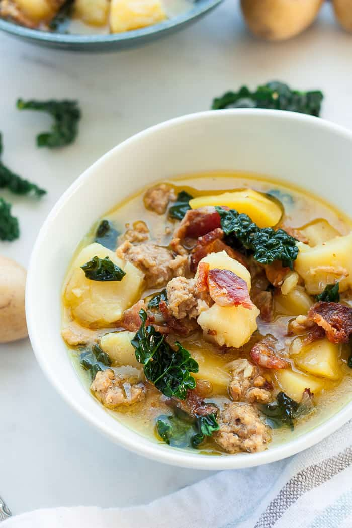 a bowl of zuppa toscana with kale