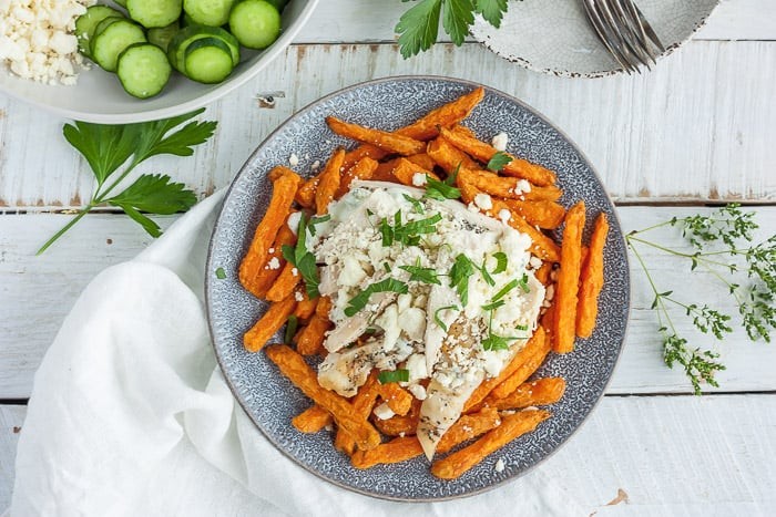 sweet potato fet fries with parsley on a grey plate
