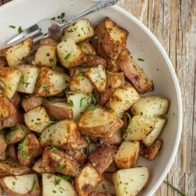 ranch potatoes with parsley and a fork