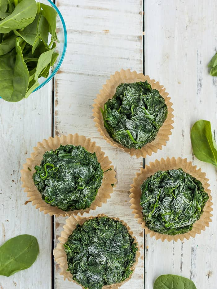 4 pucks of frozen spinach in cupcake liners