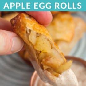 A hand dipping an apple pie egg roll into yogurt dip