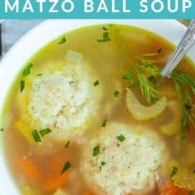 A white bowl of Instant Pot Matzo Ball Soup