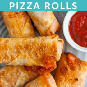 a stack of pizza rolls on a grey plate with a bowl of pizza sauce