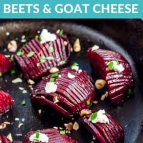 Hasselback roasted beets in a cast iron skillet topped with goat cheese