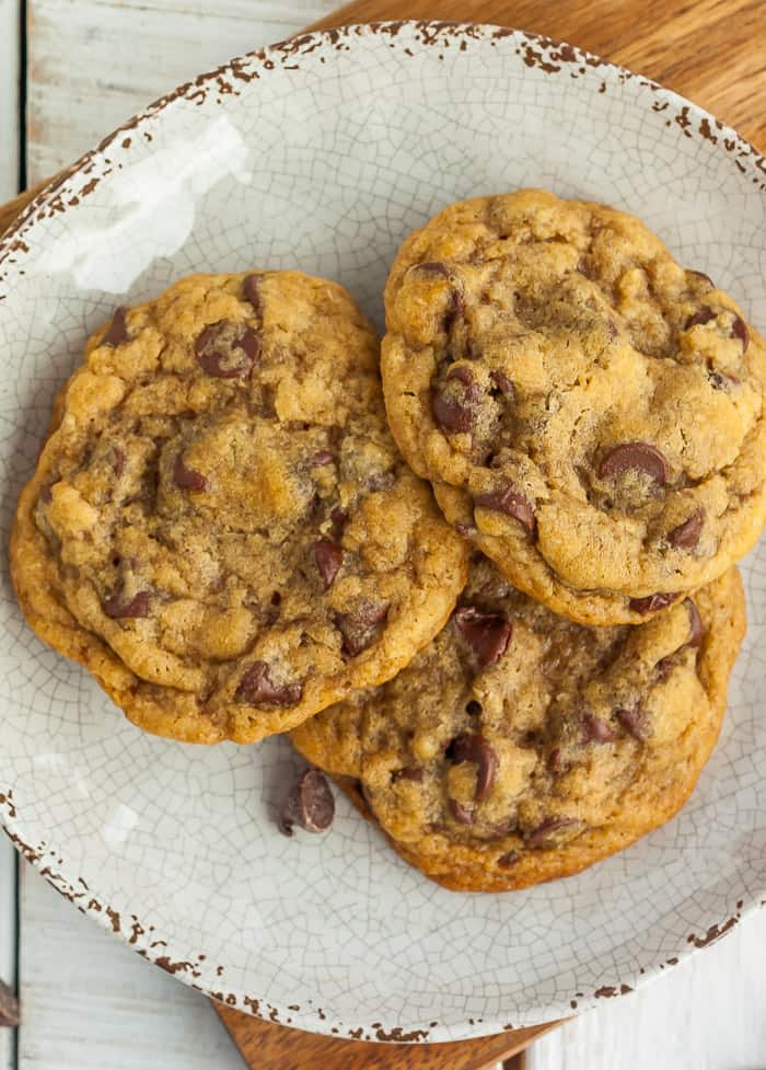 an upclose photo of 3 air fryer chocolate chip cookies on a beige plate