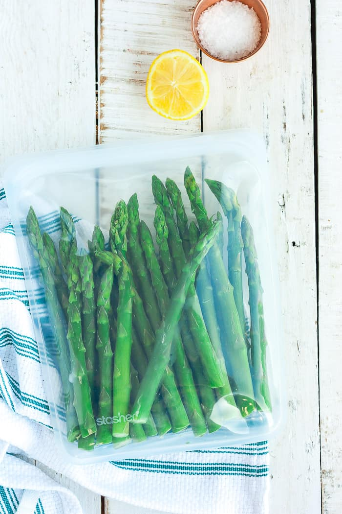 a freezer bag full of asparagus stalks