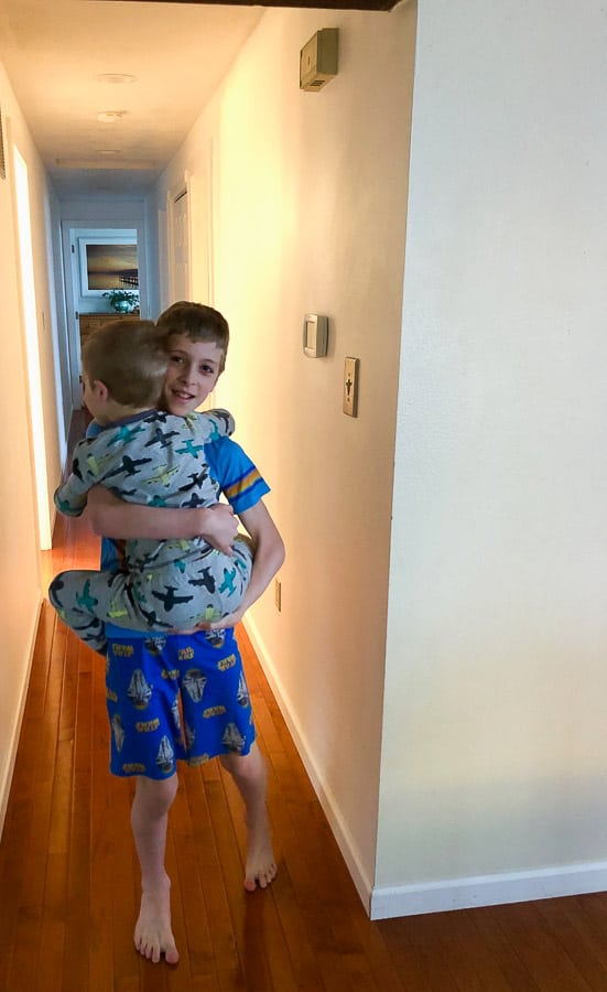 a boy carrying his younger brother