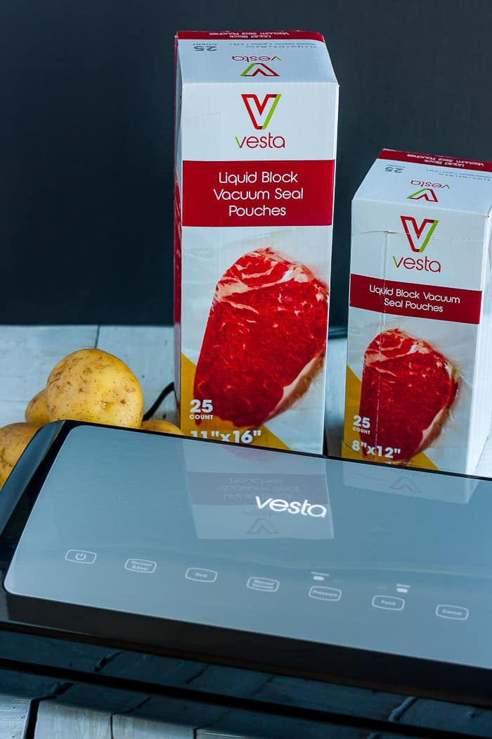 A vesta Precision vac seal elite with potatoes and vac seal bags on a white board