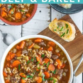 two bowls of Instant Pot Beef Barley soup on a board with sliced garlic bread