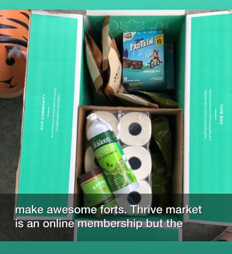 a box of groceries and toilet paper in a Thrive Market box