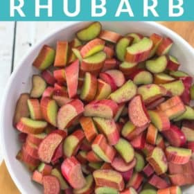 a white bowl with chopped rhubarb on a cutting board
