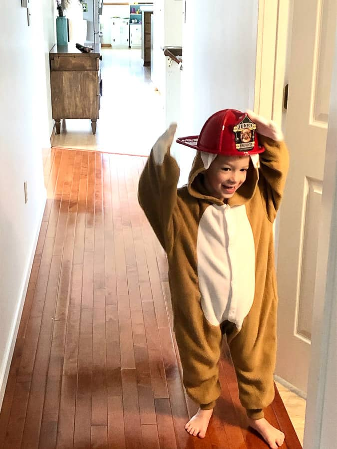 a boy in a sloth costume