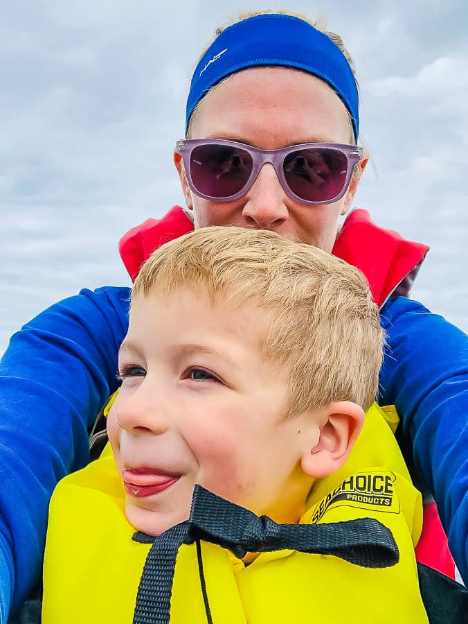 a mom and a little boy in a kayak