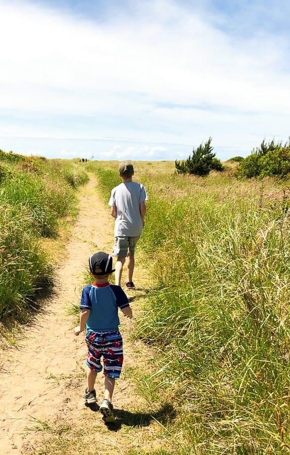 kids running on a beach