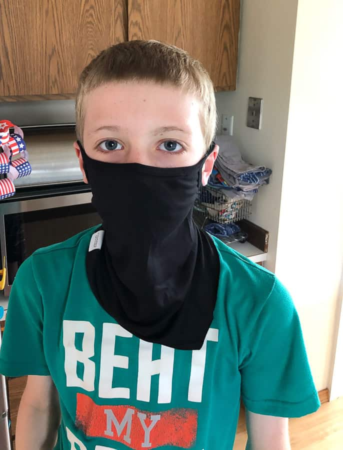 a boy in a face mask