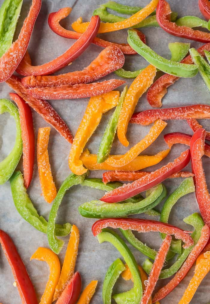 sliced peppers of different colors on a tray