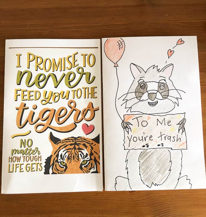 2 cards - 1 with a tiger and 1 with a raccoon
