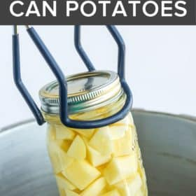 tongs lifting a mason jar of potatoes out of a canner
