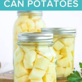 3 jars of canned potatoes on a wooden board