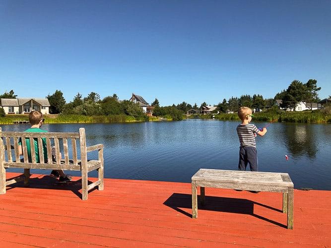 2 boys fishing on a dock