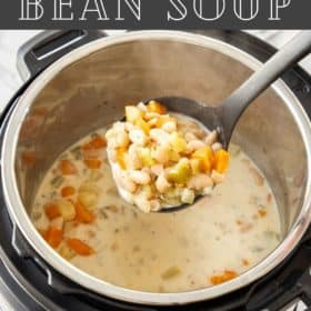 a spoon lifting a bite of instant pot bean stew