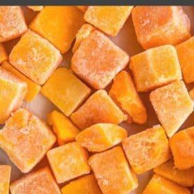 Cubes of frozen pumpkin on a baking tray