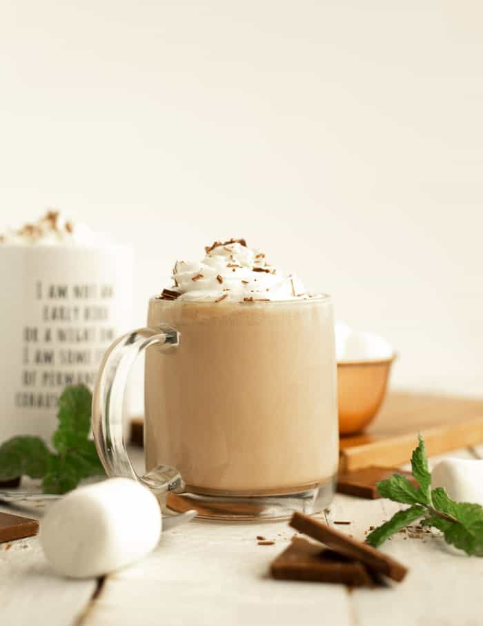 a mug of hot chocolate topped with whipped cream