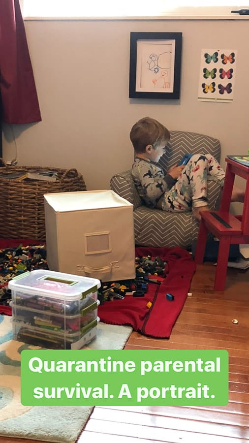 a child sitting in a small chair in a messy room